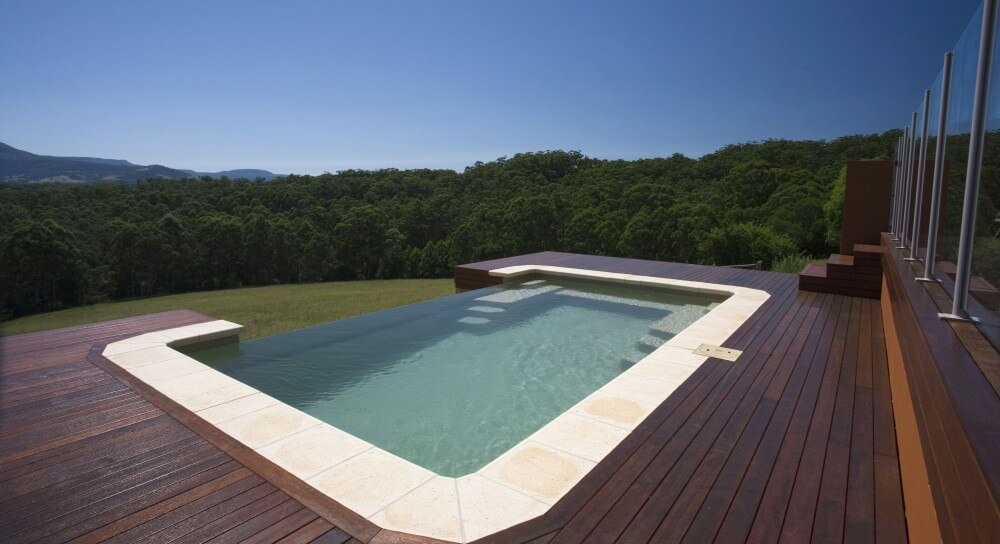 Infinity swimming pool with timber decking